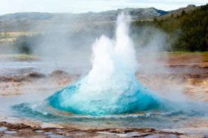 detail shot of hot spring strokkur on iceland, in the first second of eruption